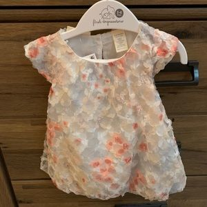 First impressions floral dress. NWT
